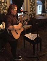 Finlay Leslie performing at Lesbians Wot Lunch